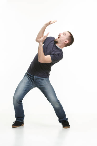 young cool man full body scared pose. stock photo