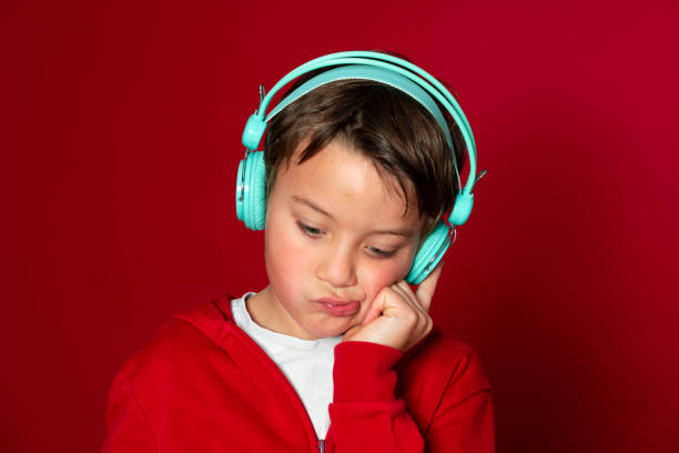 Young cool schoolboy with turquoise headphones and red sweater picture id1293747716?b=1&k=6&m=1293747716&s=612x612&w=0&h= 3mmkzgqz5k2 rmqswck q6ab5dqiv8w jkc1z5c bm=