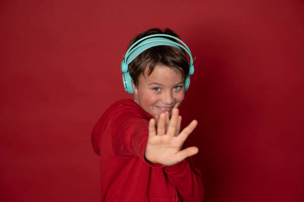 Young cool schoolboy with turquoise headphones and red sweater picture id1293747717?b=1&k=6&m=1293747717&s=612x612&w=0&h=qjnrhnrysygyjr9bhya7ywa1y46xmm5ry9  ce8h2fw=