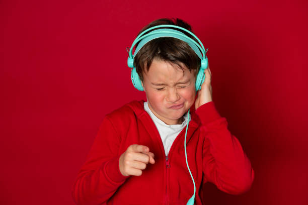Young cool schoolboy with turquoise headphones and red sweater picture id1293747739?b=1&k=6&m=1293747739&s=612x612&w=0&h=v6ud4remn ega4 7nd7qz8gyyh owppyvn3ckl ijq0=