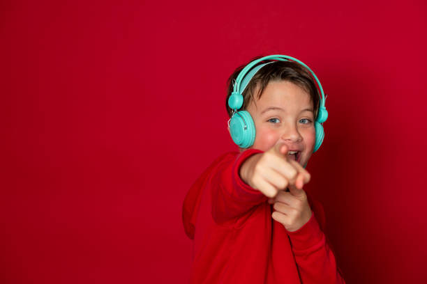 Young cool schoolboy with turquoise headphones and red sweater picture id1293747766?b=1&k=6&m=1293747766&s=612x612&w=0&h=qdspuytabccg8j7u2oco wpc3oivjo5i0db rodkepc=