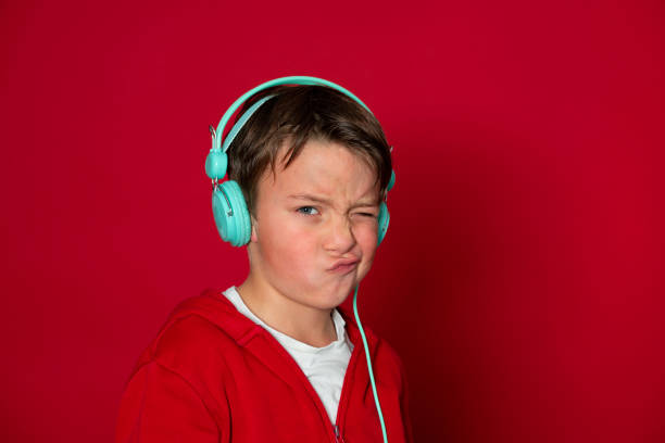 Young cool schoolboy with turquoise headphones and red sweater picture id1293747783?b=1&k=6&m=1293747783&s=612x612&w=0&h=sqdlzvnbqexheq8joqzy7jfu5llwdpdxzsh6aqkx 9a=