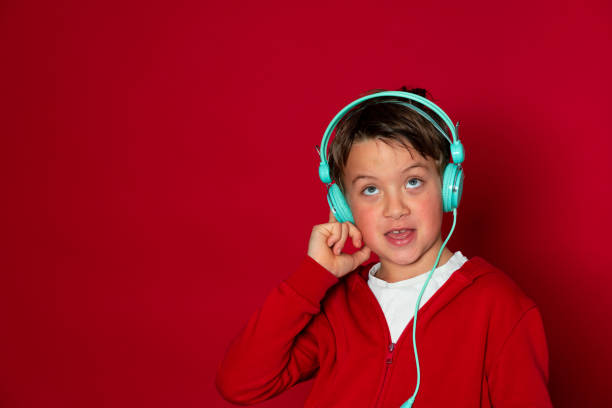Young cool schoolboy with turquoise headphones and red sweater picture id1293747784?b=1&k=6&m=1293747784&s=612x612&w=0&h=80df8wb5dq8e1t3apjzs7 foa33kjq7ajh6k698qk3o=