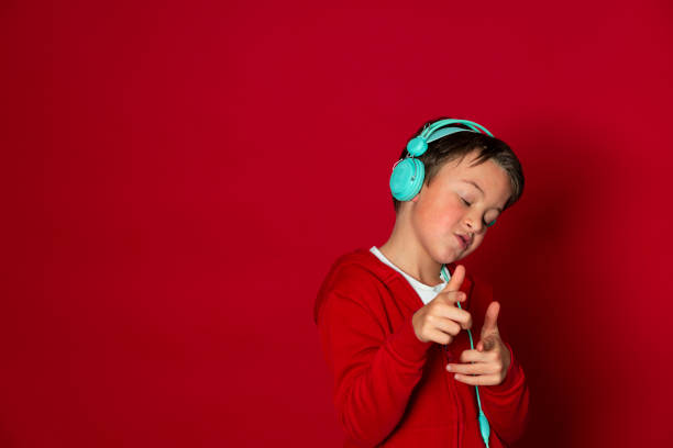 Young cool schoolboy with turquoise headphones and red sweater picture id1293747837?b=1&k=6&m=1293747837&s=612x612&w=0&h=kpqw0ymnefbw6za5nqztb8cvpdrusdjrbxdgx0kxy0e=