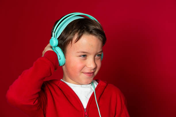 Young cool schoolboy with turquoise headphones and red sweater picture id1293747880?b=1&k=6&m=1293747880&s=612x612&w=0&h=xrvjexi9tbpdar 5npcukmujvh9ud a3vivozrqbcig=