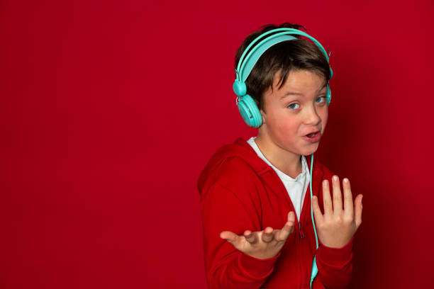 Young cool schoolboy with turquoise headphones and red sweater picture id1293747889?b=1&k=6&m=1293747889&s=612x612&w=0&h=ryihleky3au5smiejm76yqepwrppif nwfrcxpv1i24=