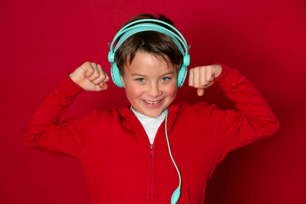 Young cool schoolboy with turquoise headphones and red sweater picture id1293747890?b=1&k=6&m=1293747890&s=612x612&w=0&h=ghf1hlhnbmdji916mqkjxuildlahgvdug1egfruzkpk=