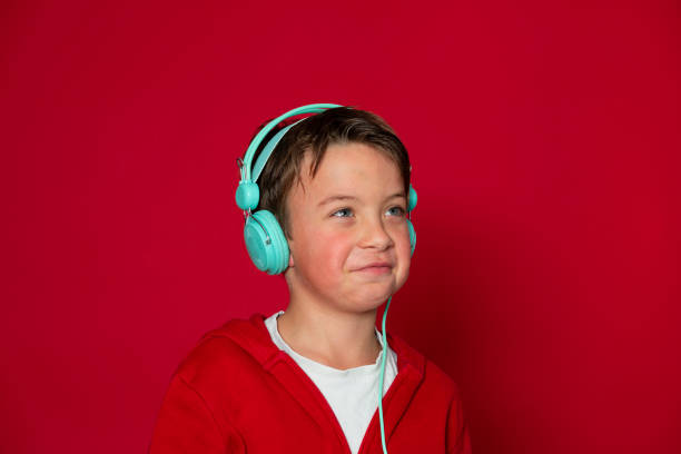 Young cool schoolboy with turquoise headphones and red sweater picture id1293747919?b=1&k=6&m=1293747919&s=612x612&w=0&h=ocya1yl8zao5 i7elfye0mkrmlwmtjiwttlg0m9sdgc=