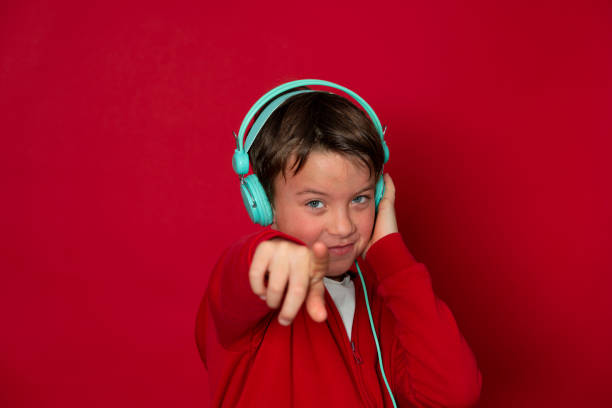 Young cool schoolboy with turquoise headphones and red sweater picture id1293747922?b=1&k=6&m=1293747922&s=612x612&w=0&h=obzzsk1takjtwakokzmlvtjro6sdaj4bl3qtxffhuci=