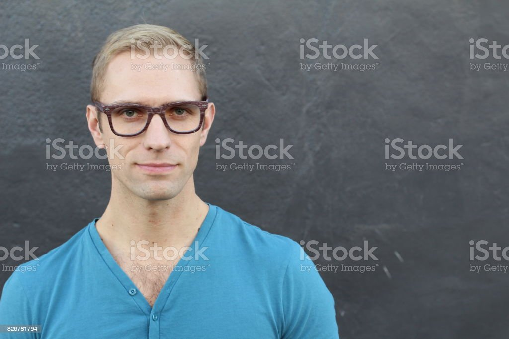 Young cool trendy man with glasses smiling stock photo