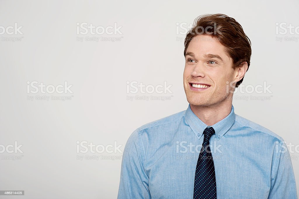 Young corporate guy looking away stock photo