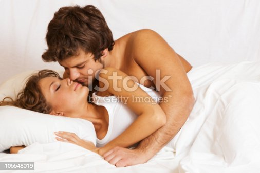 istock A young couple about to kiss in bed 105548019