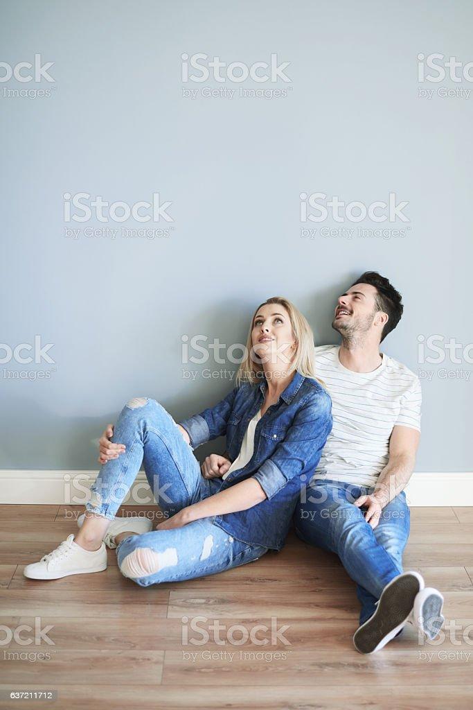 Young couple admiring home interior stock photo