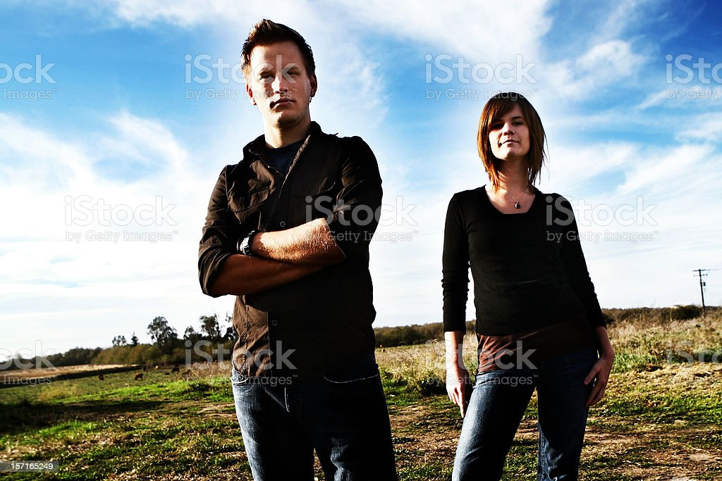 Young Couple Agianst Bright Blue Sky royalty-free stock photo