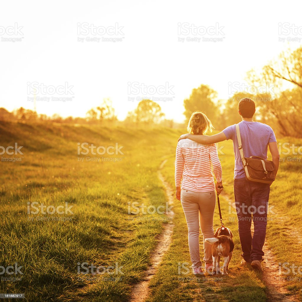 Young couple and a dog stock photo