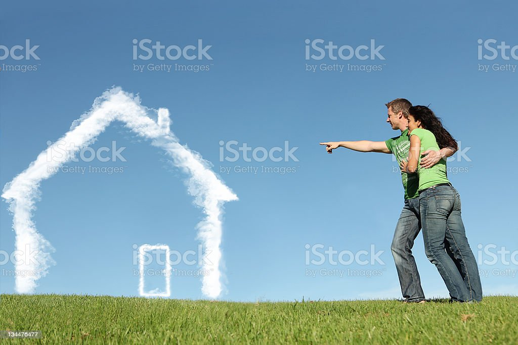 Young couple and dream house concept stock photo