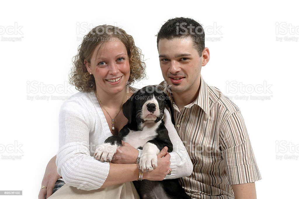 Young couple and puppy royalty-free stock photo