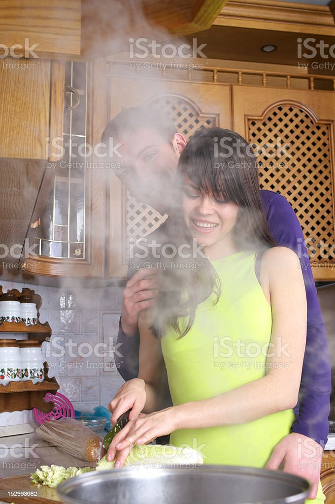 Young couple are cooking at home kitchen royalty-free stock photo