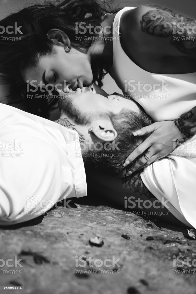Young couple are lying on the pier by the sea stock photo