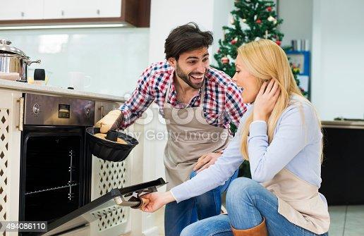 494086690istockphoto Young couple are preparing  cake for Christmas - Kugelhupf 494086110