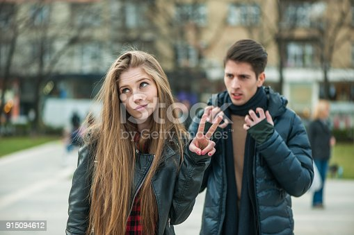 istock Young couple arguing at the street 915094612