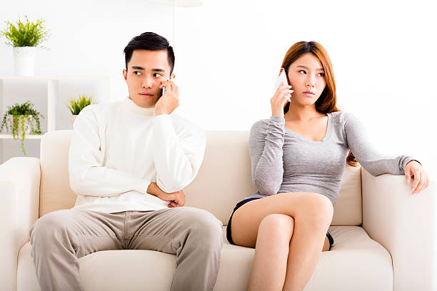 Young couple arguing  on the mobile  phones stock photo