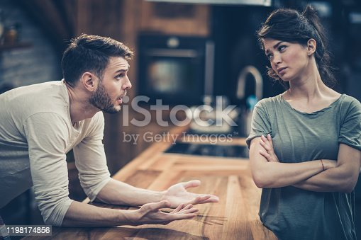 Young couple arguing about their problems at home.