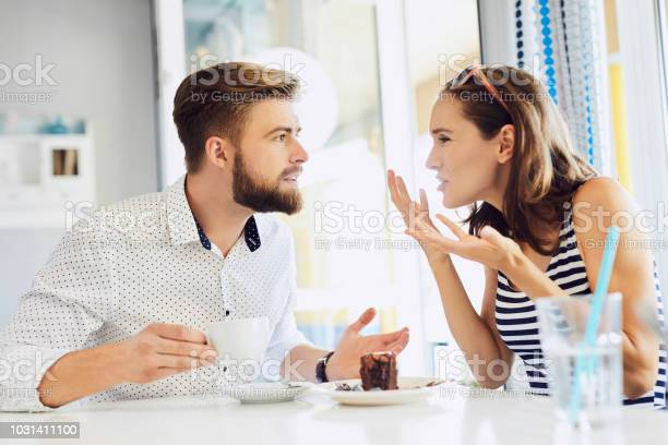 Young couple arguing while sitting and drinking coffee in restaurant picture id1031411100?b=1&k=6&m=1031411100&s=612x612&h=yr27jraiyajsudizrtxp6gwgerfg8akmvrc8hifncn8=