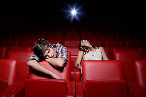 Young couple asleep in the movie theater  bad date stock pictures, royalty-free photos & images