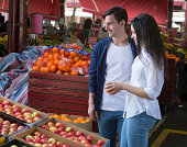 Young couple shopping at a fruit market