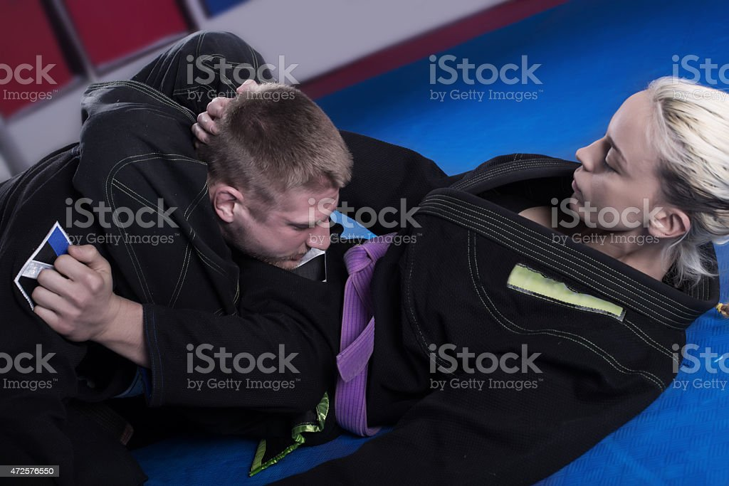 Young couple at BJJ practice stock photo