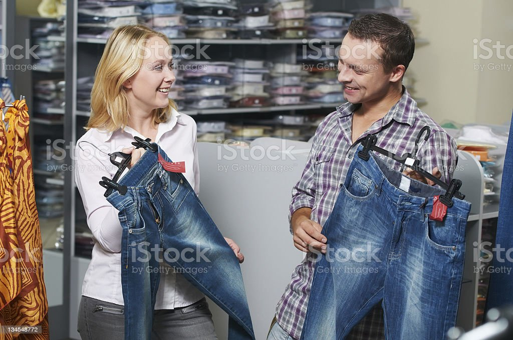 Young couple at clothes shopping royalty-free stock photo