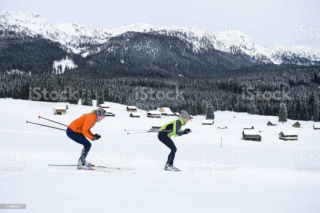 Young couple at cross country skiing downhill royalty-free stock photo