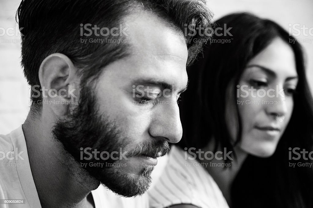 Young couple at home - Couple problem stock photo