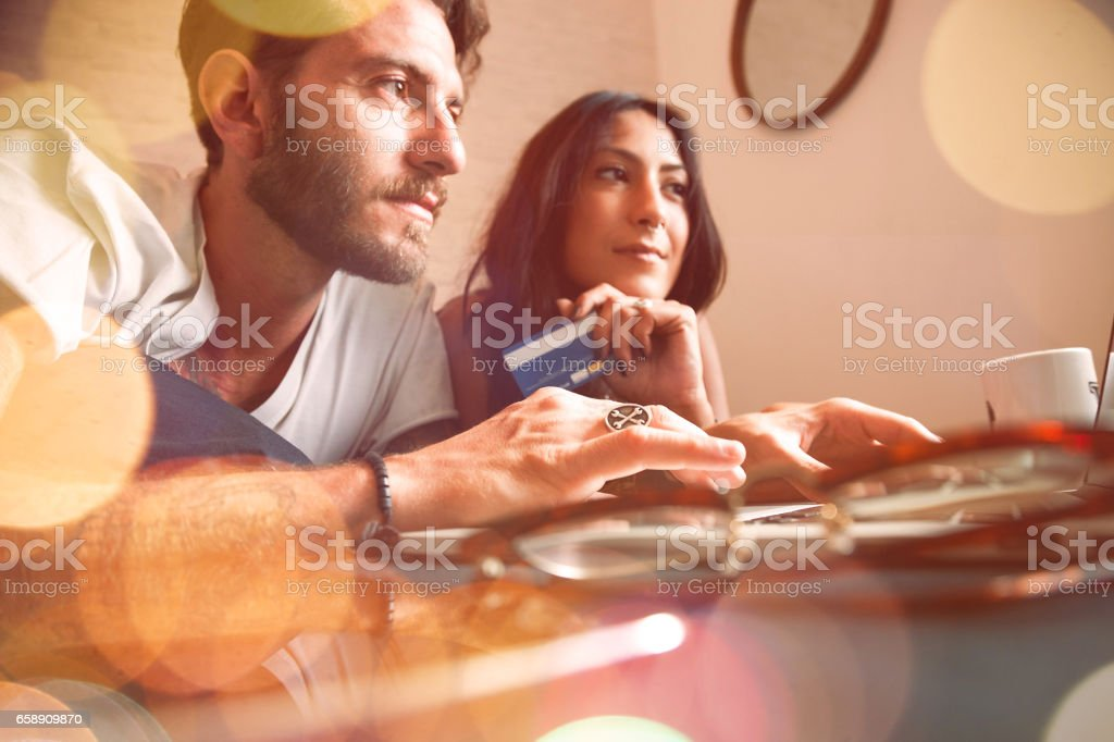 Young couple at home - Online Shopping stock photo