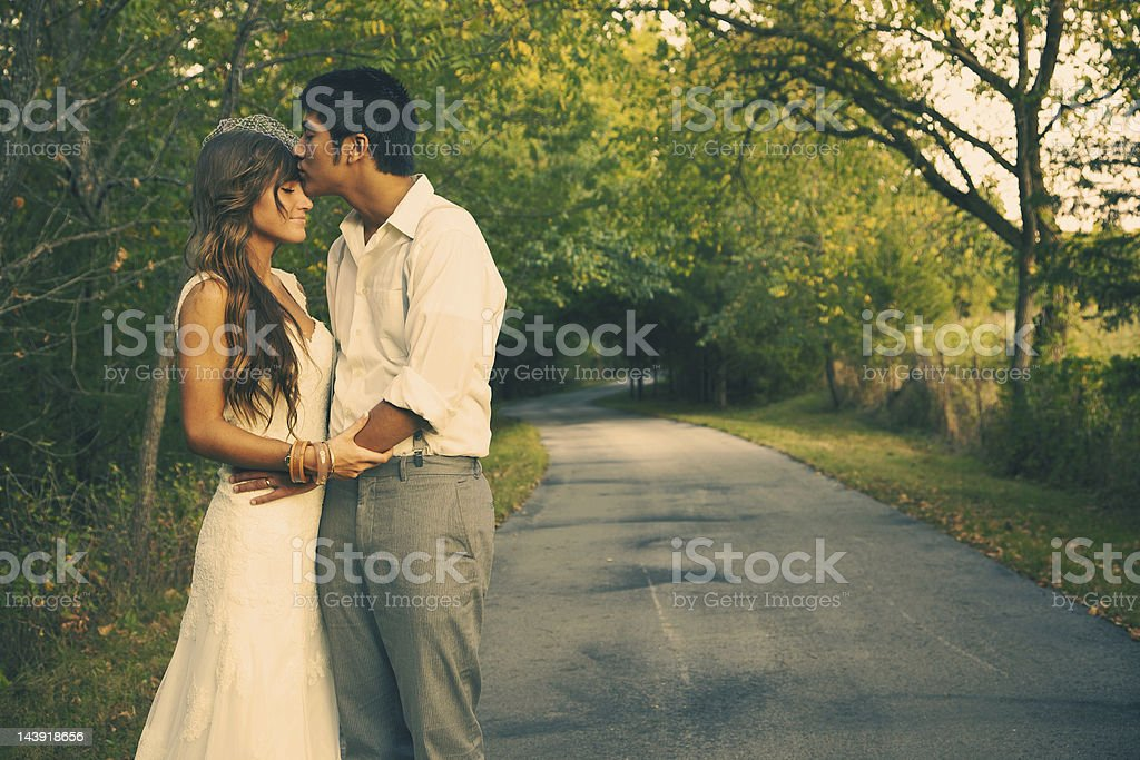 young couple at sunset on roadway marriage happiness stock photo