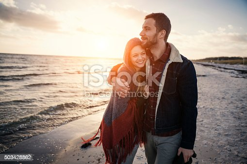 istock Young couple at the beach 503428862