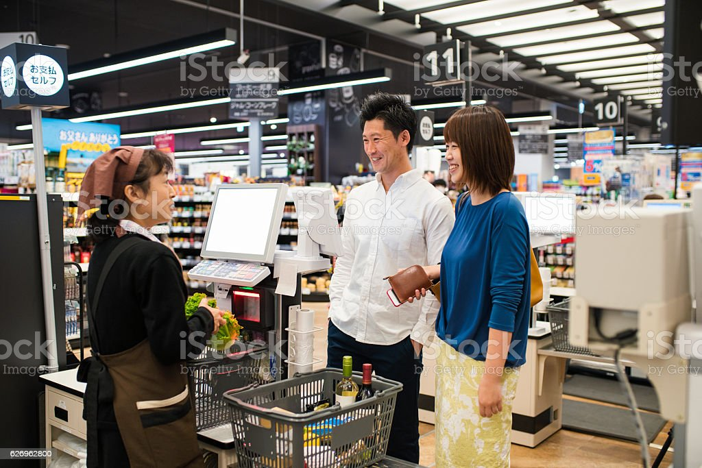 Young couple at the checkout ストックフォト