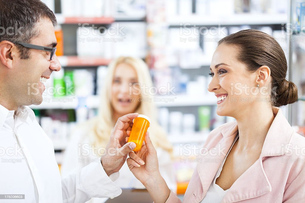 Young couple at the pharmacy royalty-free stock photo