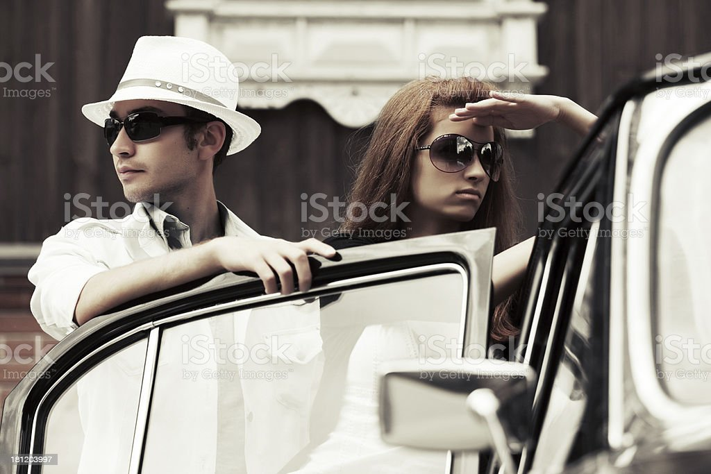 Young couple at the retro car royalty-free stock photo