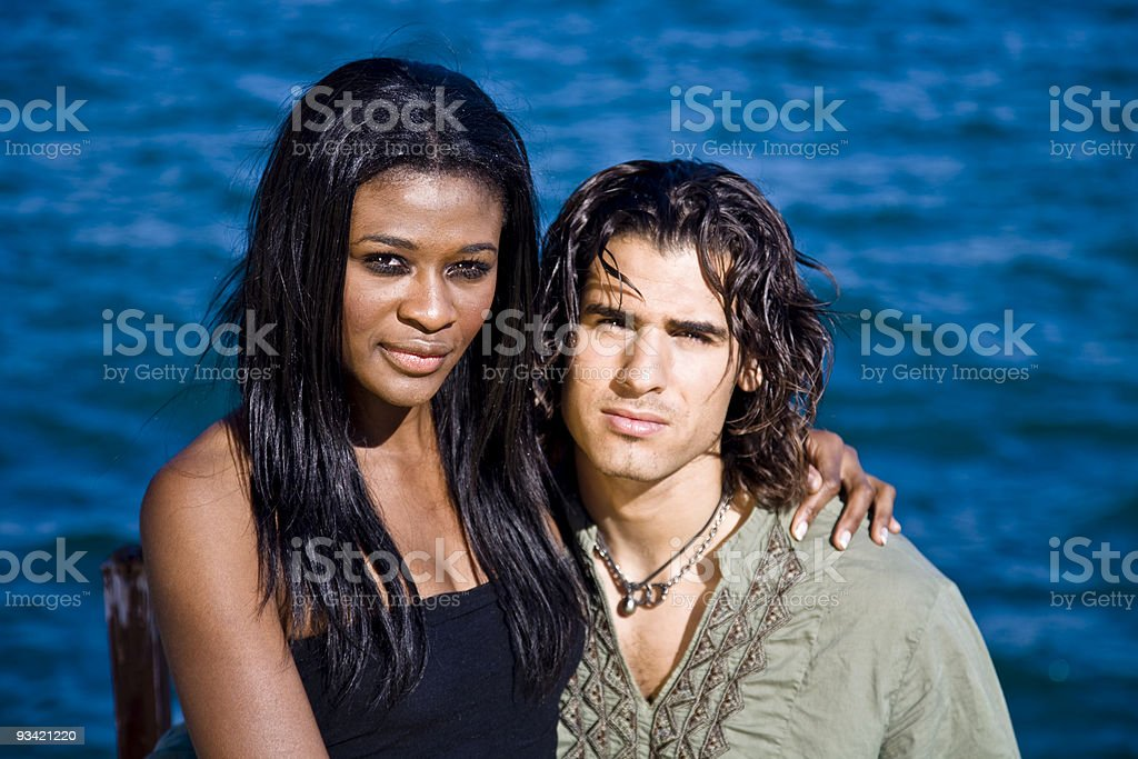 young couple at the seaside. royalty-free stock photo