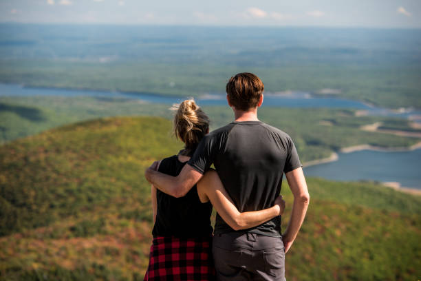 Young couple at the top of a beutiful mountain. stock photo