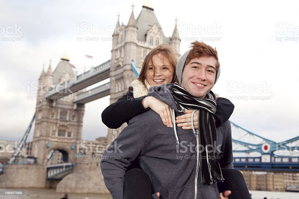 Young couple at Tower Bridge in London royalty-free stock photo