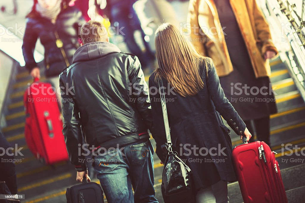 Young couple at train station royalty-free stock photo
