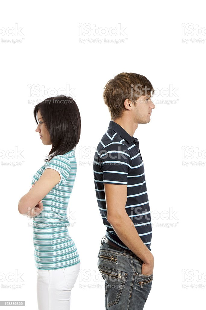 young couple back to each other stock photo
