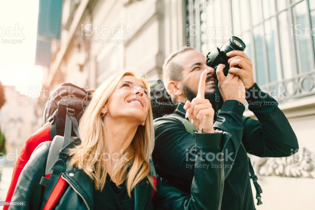 Young Couple Backpackers Photographing stock photo