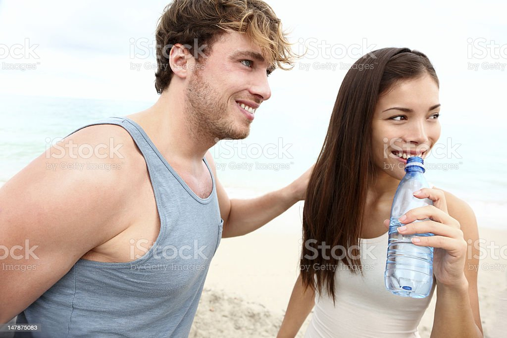 Young couple beach workout royalty-free stock photo