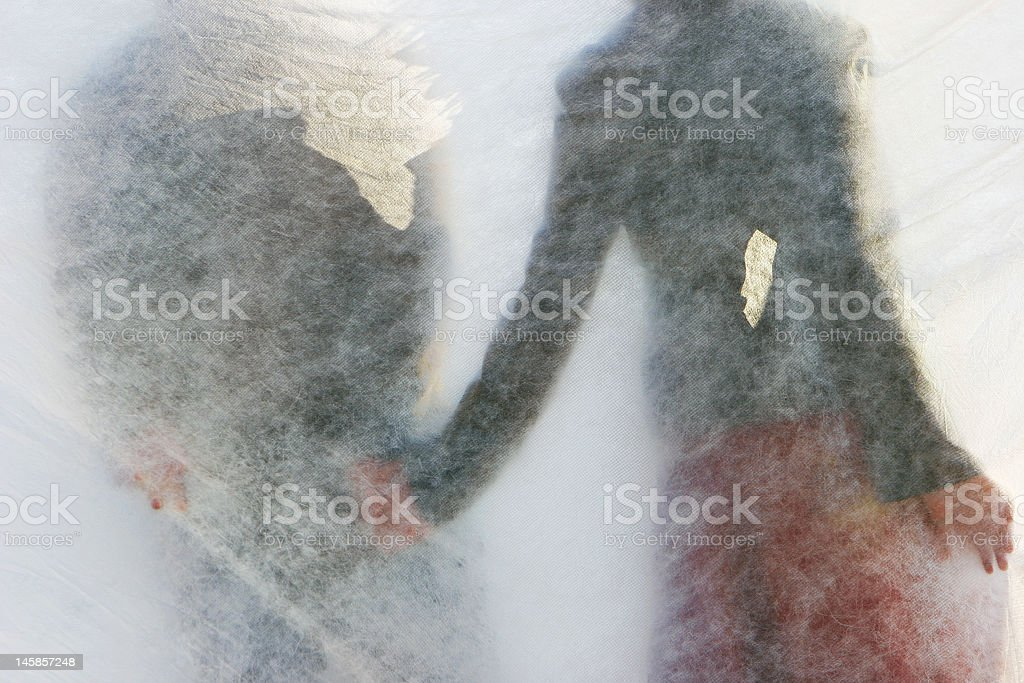 young couple behind transparent curtain royalty-free stock photo