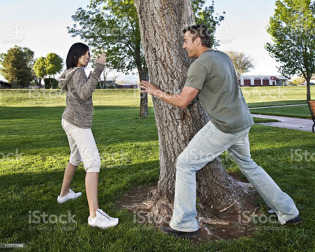 Young Couple being Playful in the Park. stock photo