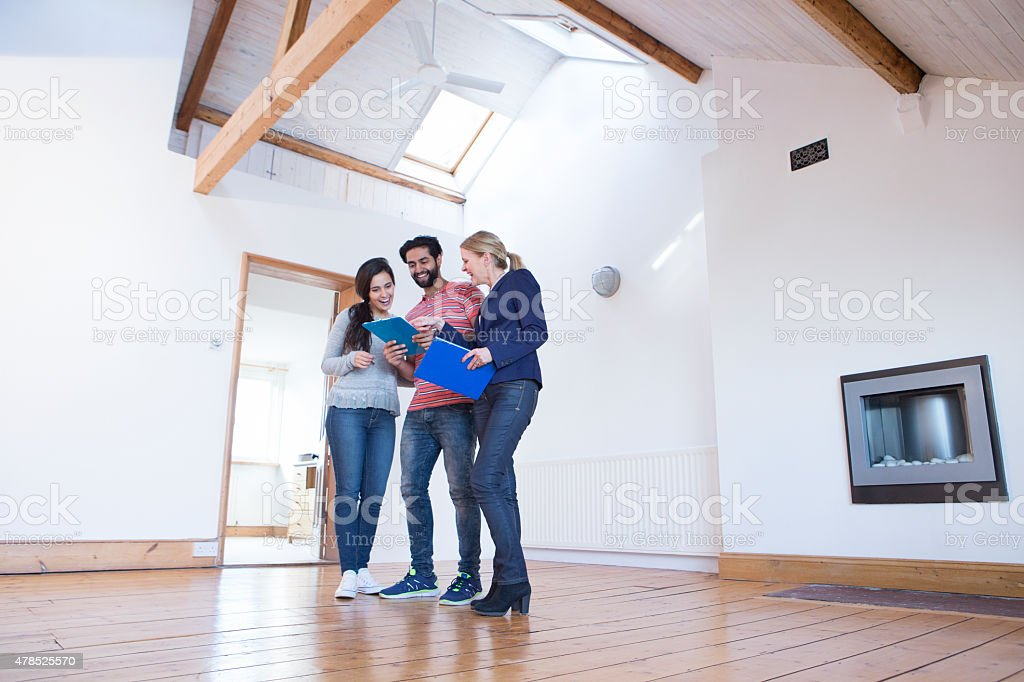 Young Couple Being Shown a New Home stock photo